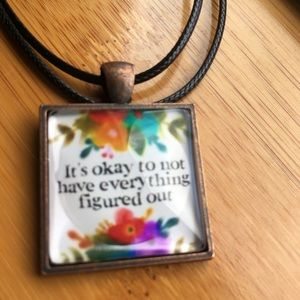 Glass pendant necklace the says it's okay...